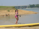 This girl loves the water, the sand, the casting and reeling
