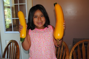 Lili planted the yellow squash and is very proud of her accomplishments.