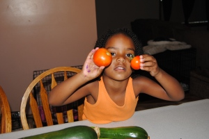 Naomi helped pick the tomatoes and needed to be in a picture too.