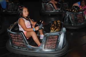 Lili enjoying the bumper cars at Miner Mike's.