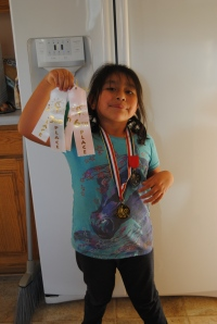 Lili with her Horse Show awards.