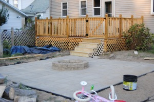 Our rebuilt deck leading down to our new patio.  The fire pit is lonely no more!!