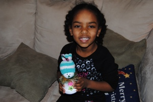 Naomi with her snowman.