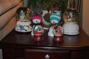 Snowmen taking their place among the snow globes.