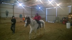 Lili riding Shatan.  No more pony rides for her.  She is on a horseback.