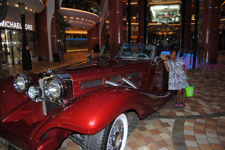 Naomi really wanted to get her picture taken next to this car. It was parked on the ship.