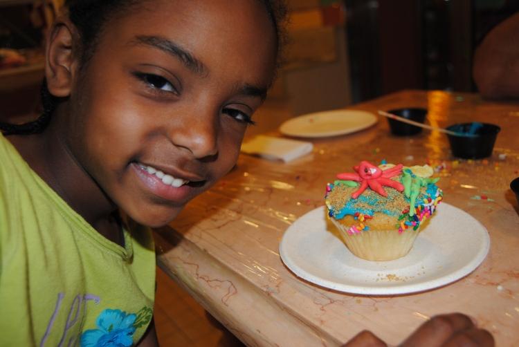 Naomi and her cupcake creation.