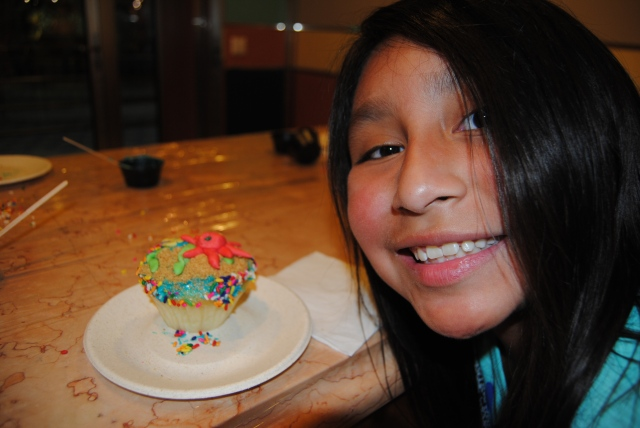 Lili and her cupcake creation.
